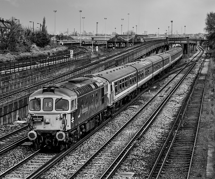 """33116, 4-CEP No. 2304 and 4-CIG No. 1886 passing Wimbledon Park  with 1Z40, <br /> the 09:45 Waterloo - Waterloo, on 1st April 1994. This was the """"Strawberry Fool"""" organised by Hertfordshire Rail Tours. It visited Shepperton, Hampton Court, Chessington South, Littlehampton, Bognor Regis and Norwood Junction. Scanned Negative."""