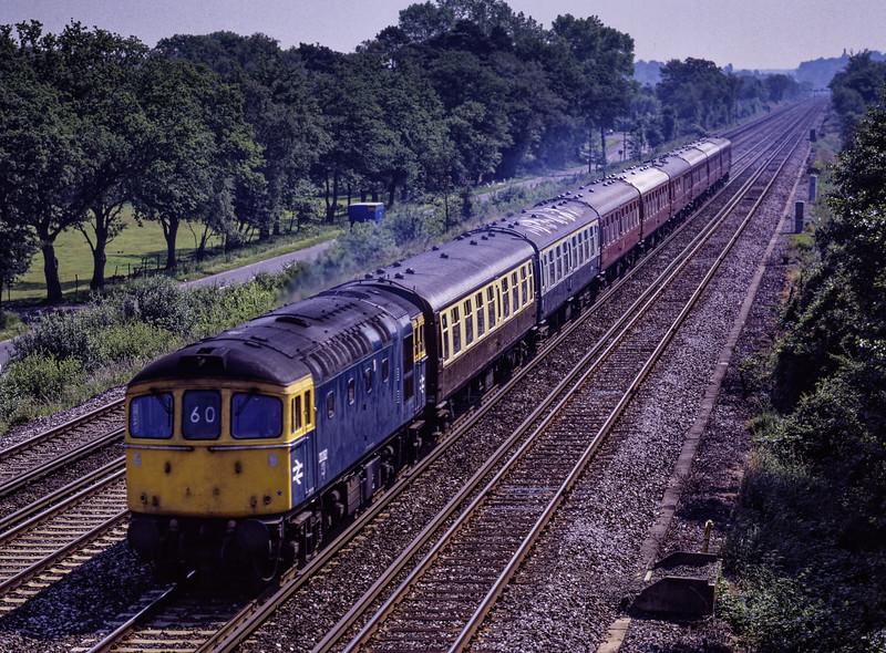 """33062 running between Farnborough and Fleet with the 09:58 Waterloo - Salisbury, """"Blackmore Vale Express"""" on 20th June 1987. This was a special organised by British Rail, and would feature two return trips from Salisbury to Yeovil Junction, one with <br /> """"Flying Scotsman"""" and the other with"""" Clan Line"""" Scanned Transparency."""