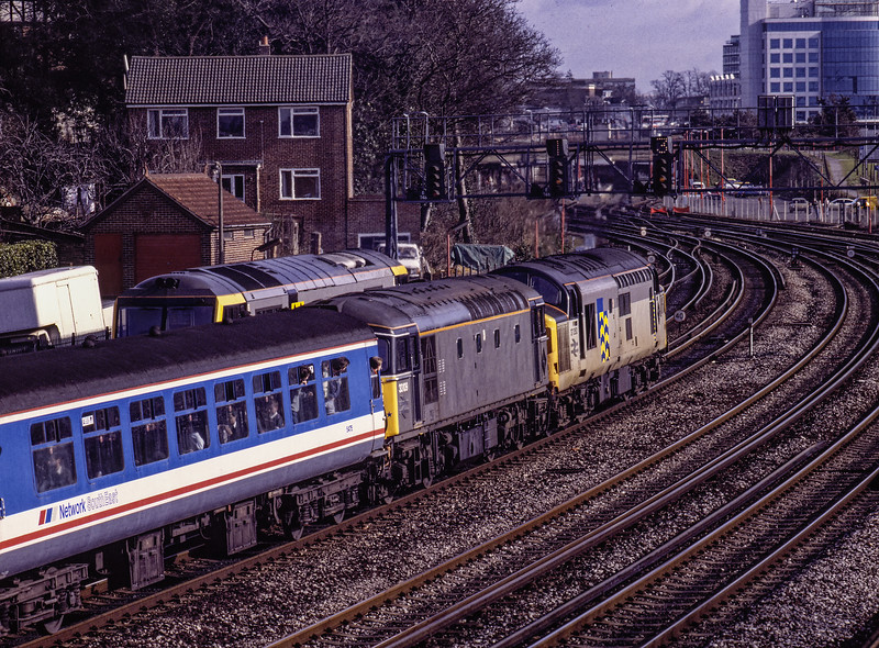 """37350 and 33109 approaching Southampton with 1Z24, the 10:12 Waterloo - Weymouth, <br /> on 16th February 1992. This was the """"Solent and Wessex Wanderer"""" organised by Network SouthEast. The train had travelled via Laverstock because of engineering work. This would require a reversal at Southampton, where a loco swap would also be carried out. <br /> Scanned Transparency."""