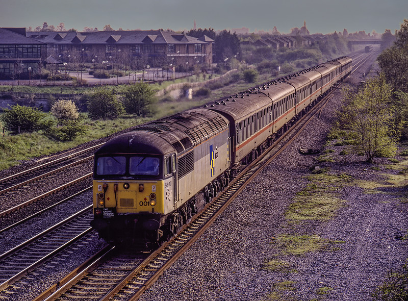 """56001 at White Waltham, with 1Z33, the 08:03 Paddington - Paddington, via Morris Cowley, Eastleigh, Hamworthy Goods, Fawley, Laverstock, Basingstoke and Reading, <br /> on 20th April 1992. This was the """"Crewe Avoider"""" organised by Hertfordshire Railtours. <br /> This tour was originally advertised as """"The Hampton Wanderer"""" taking in branches near Southampton and Northampton (Brackmills). Unfortunately shortly before the tour BR at Crewe announced a ban for running tours over LMR freight lines. A hasty re-organisation courtesy of BR (WR) and (SR) enabled a tour still to be run on this date, steering well clear of the LMR (hence the name) Scanned Transparency."""