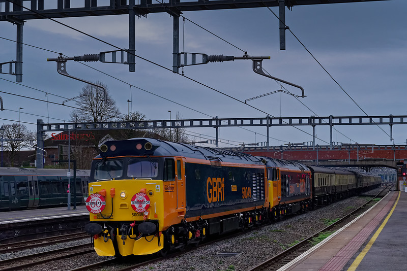"""50049 and 50007 flying though Newbury with 1Z50, the 07:08 Paddington - Penzance, """"Class 50 Terminator Phoenixed!"""" railtour, run by Pathfinder Railtours on 23rd March 2019. <br /> Newly applied GBRf livery, much in evidence."""
