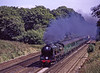 "WC No. 34016 ""Bodmin"" at Totters Lane, Potbridge, with the 10:58 Waterloo - Salisbury, <br /> ""Cathedrals Express"" on 30th August 2000. Scanned Transparency."