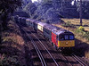 """33021 at Crown Lane, Badshot Lea with ECS from Alton to Victoria, on 23rd August 2000. <br /> WC No. 34016 """"Bodmin"""" was on the rear, ready to work a special from Victoria. <br /> Scanned Transparency."""