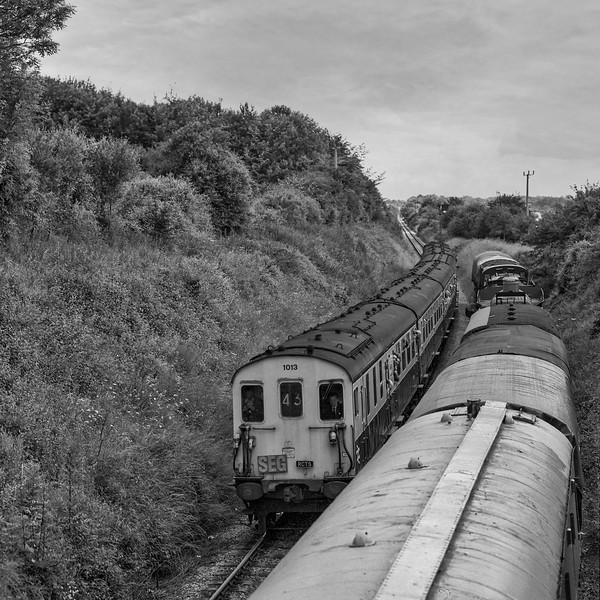 """Hasings DEMU No. 1013 approaching Ropley with 1Z48, the """"Hampshire Hog"""" railtour organised by the S.E.G. and the R.C.T.S. on 20th July 1985. I believe this to be the first through working of a passenger train since the line was re-opened. Scanned Negative."""