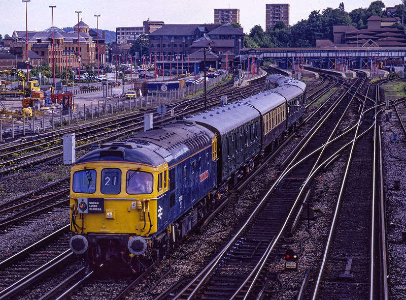 """33116 departs from Guildford with 1Z22, the 14:10 Salisbury - Waterloo <br /> """"Ocean Liner Express"""" on 15th May 1994. Scanned Transparency."""