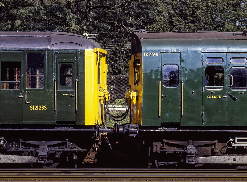 S12123S of 2-BIL 2090 and 12796 of 4-SUB 4732 during a photo-stop at Winchfield, <br /> on 27th September 1987. The veteran units were working 2Z61, <br /> the 11:00 Basingstoke - Woking. This was a special service in connection with the Basingstoke Rail Show. Scanned Transparency.