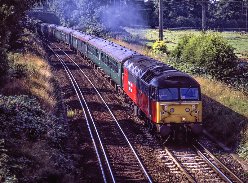 """47776 at Crown Lane, Badshot Lea with ECS from Alton to Victoria, on 15th August 2001. <br /> WC No. 34016 """"Bodmin"""" was on the rear, ready to work a special from Victoria. <br /> Scanned Transparency."""