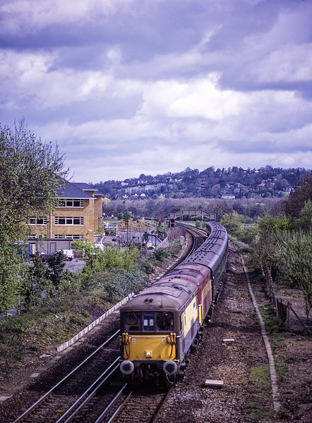 """73101 and 73131 pass the site of the former Peasmarsh Junction, with 1Z86, <br /> the 09:00 Victoria - Poole, on 28th April 2001. This was the """"Wessex Venturer"""" organised by Hertfordshire Rail Tours. This was taken from the road bridge at Peasmarsh, not something that I would recommend today. Scanned Transparency."""
