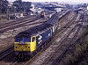 """47817 setting back into platform 1 at Andover with 1Z37, the 06:21 Manchester - Whatley Quarry and Merehead Quarry, on 31st March 1990. This was the """"Mendip Quarryman"""" organised by Pathfinder Tours.Scannned Transparency."""