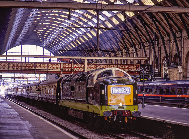 """D9009 arriving at Kings Cross with the 11:35 York - Kings Cross, on 22nd May 1999. <br /> These tours were billed as the """"Mainline Debut Tours"""" <br /> organised by the Deltic Preservation Society. Scanned Transparency."""