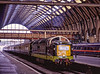 "D9009 arriving at Kings Cross with the 11:35 York - Kings Cross, on 22nd May 1999. <br /> These tours were billed as the ""Mainline Debut Tours"" <br /> organised by the Deltic Preservation Society. Scanned Transparency."
