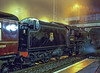 Black Five No. 45407 taking water at Blackwater, while working a steam special back to Alton, on 1st April 2000. Scanned Transparency.