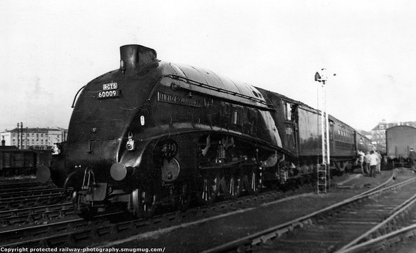 60009 Union of South Africa water stop at Glasgow St Johns. with with the 'Scottish Lowlander' on 26th September 1964