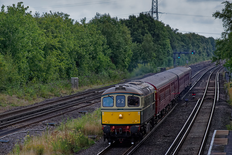 """33012 top & tailed with 73107 on the London Underground TC Unit. Shown passing Winchfield, with 1Z82, the 09:02 Waterloo - Warminster. This was UK Railtours """"By Routemaster to the Lost Village of Imber"""" railtour, on 17th August 2019."""