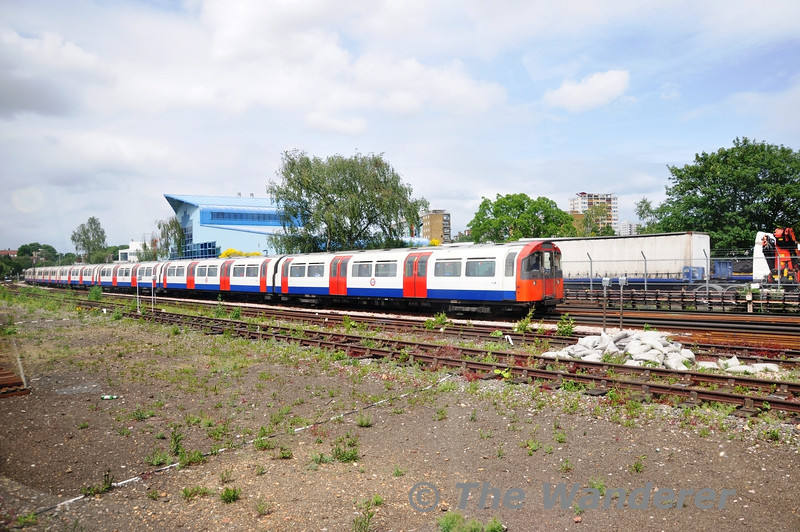73 stock DM 214 leads a Piccadilly line train out of Acton Town. The railtour special was stabled in one of the 3 reversing sidings  at this point awaiting its departure time to Ealing Common.  Sun 15.05.11
