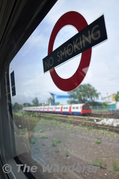 The iconic No Smoking sign on the London Underground System as seen on a window of 4171. Sun 15.05.11