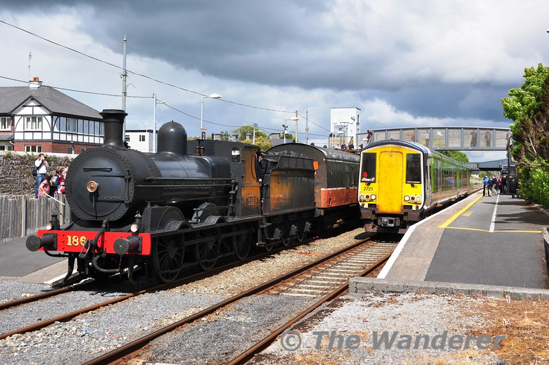 2720 + 2721 depart Athenry with the 1430 Galway - Limerick. 186 waits with its train which will head down the WRC in one hours time. Sat 12.05.12