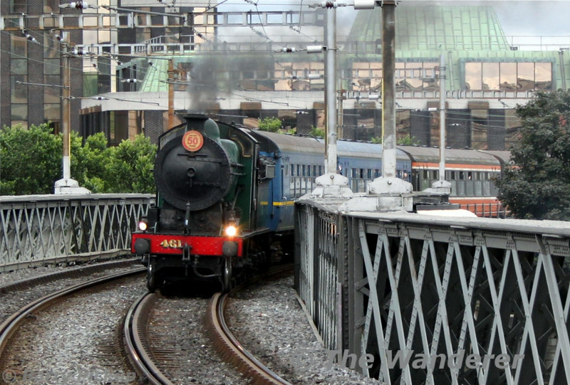 "461 crosses the Loop Line Bridge at Tara Street with the 1035 Connolly - Wicklow ""Bray Shuttle"". Sun 13.07.14<br /> <br /> Photo courtesy of Barry Pickup."