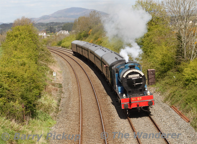 RPSI locomotive 85 Merlin passes Dromiskin (MP 48.75) en route from Whitehead to Dublin Connolly on May 7th 2015 with six RPSI Mk II coaches. Forkhill and Slieve Gullion in Co Armagh are visible in the background. Thurs 07.05.15<br /> <br /> Picture courtesy of Barry Pickup.
