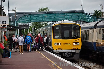 2802 + 2801 stand at Ennis with the 1030 Galway - Ennis. A healthy load of customers leave and board the train here. Wed 13.06.18
