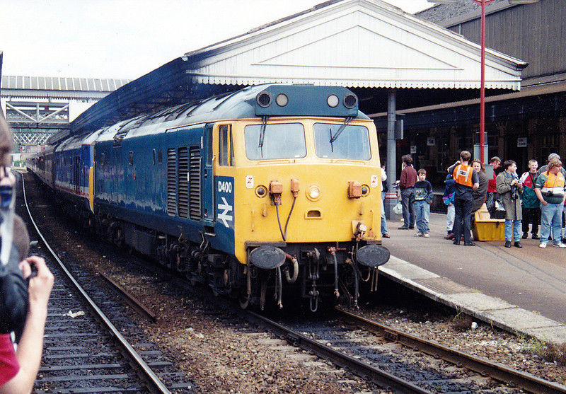 The bunfight scramble for a shot prior to departure! <br /> D400+50033 await 'right away' time at Exeter St Davids at the head of the 1Z43 'The Cornishman' CFA railtout on 31st May 193