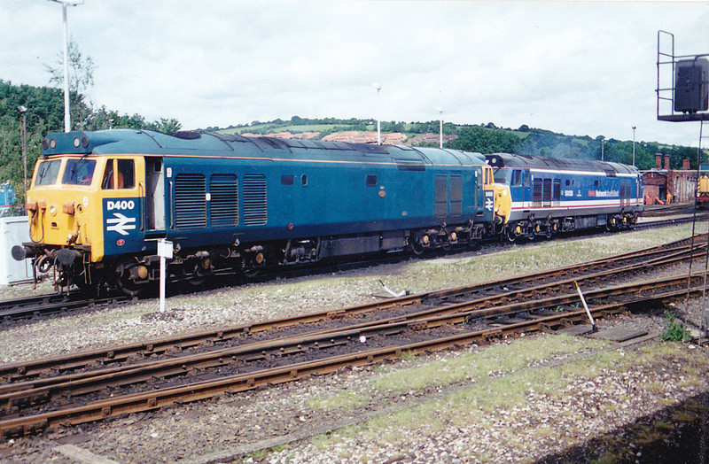 D400+50033 waiting in the wings to replace 37073 ++37110 on the 1Z43 06:50 Crewe to Penzance CFA 'The Cornishman' on 31st May 1993