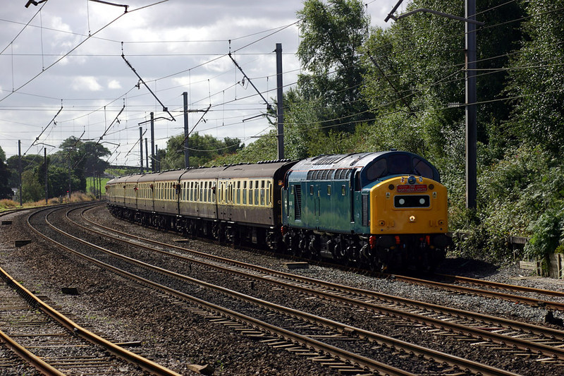 """40145 is recessed at Oubeck Loop near Lancaster with the 1Z50 08:15 Birmingham International to Inverness leg of the """"Northern Lights"""" Railtour on 27th August 2004.  The Whistler was later declared a failure and the remainder of the tour was handled by 50031"""