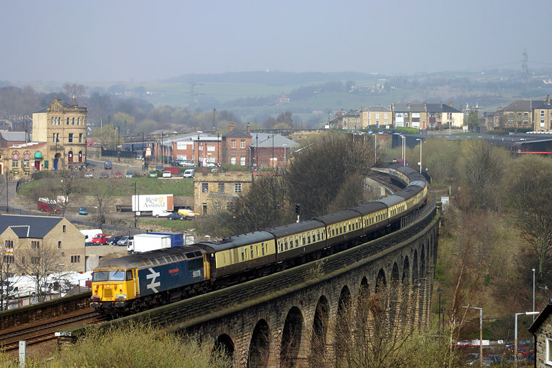 """56078 rolls over Union Mills Viaduct Batley with the 1Z57 York to York (via Hebden Bridge, Manchester & Diggle) """"mini-tour"""" section of the hastily arranged Pathfinder Tours """"Twilight of the Grids"""" on Wednesday 31st March 2004"""