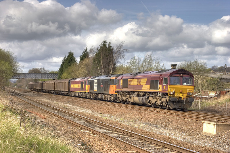 66197 pilots dead in transit tugs 60004+60008 past the site of the former Mirfield MPD in the consist of the 6E33 Knowsley to Immingham vans on 12th April 2005