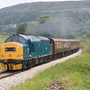37214 storms up Oakworth bank with the 11:30 Keighley to Oxenhope on 18th June 2005