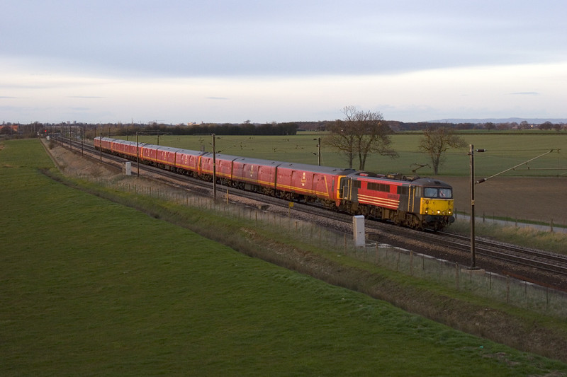 87026 catches the very last rays of the evening sun as she speeds south at Colton with a diverted 1M44 Glasgow Shieldmuir-Wilsden PRDC GBRF mail train 18-04-06.  800ISO 1/500th at f3.5 was required!