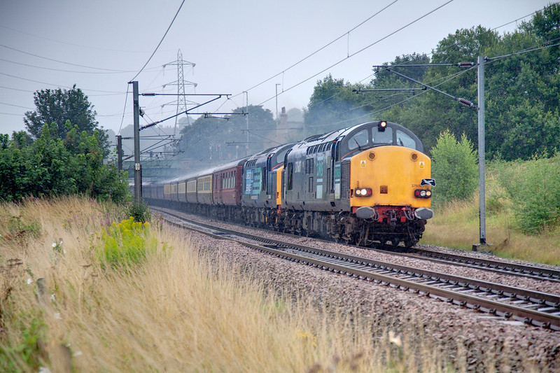 After reversal at Leeds the tour continued north behind 37607+37604 which had been dragged dead on the rear to Leeds.  The train is seen here passing Kirkstall playing fields