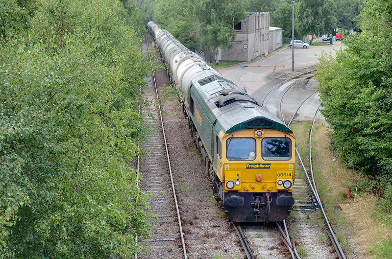 66614 is seen shunting wagons at Dewsbury Cement Terminal on August 14th 2009