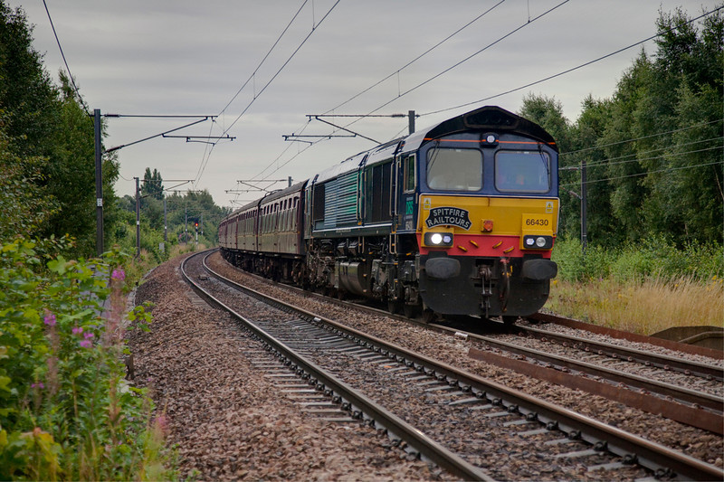 "66430 is seen passing Fox Lane Wrenthorpe, Wakefield with a 1Z20 06:14 Wolverhampton to Carlisle ""Cumbrian Crusader"" spin 'n' win charter for Spitfire Railtours on August 1st 2009"