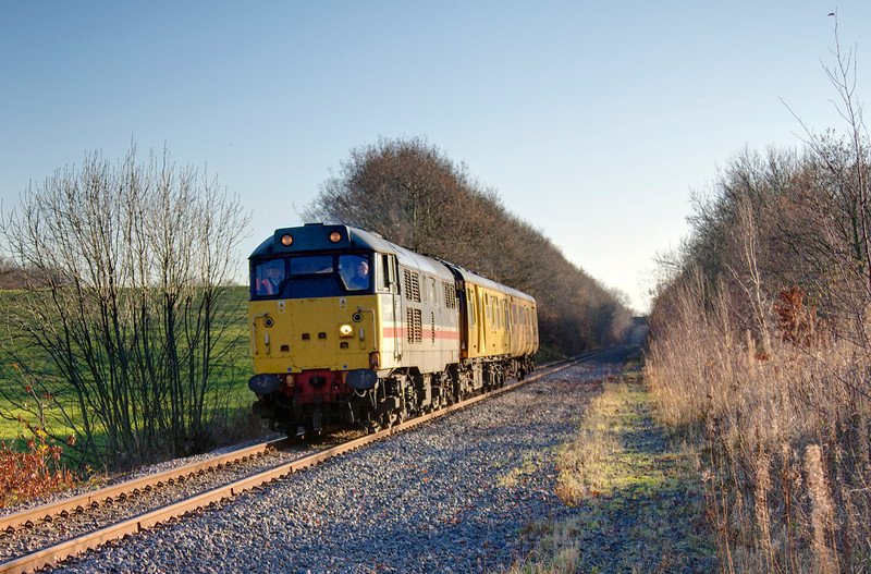 31454 leads a 2Q08 10:41 Doncaster to Derby RTC out of the cutting at Old Royston on December 4th 2010 after run around at Monk Bretton.