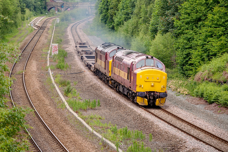 37670+37401 in Horbury Cutting at Addingford lane making light work of a 4Z20 Warrington to Marcroft (Horbury) wagon trip on June 6th 2009
