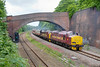 37670+37401 are seen passing under the impressive brick bridge at Addingford, Horbury cutting with a 1Z19 Carlisle to York charter for Compass tours on June 20th 2009