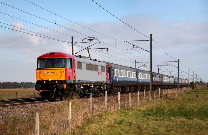 86702 at Fenwick Level Crossing with a 1Z30 Newcastle to London Kings Cross on October 17th 2009