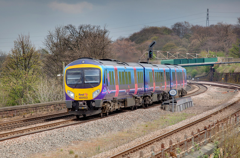 185103 crosses the rivewr Calder at Mirfield with a 10:50 Scarborough to Liverpool Lime Street on April 25th 2010.