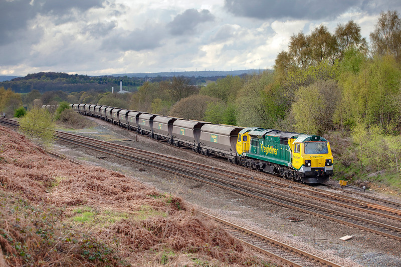 70005 lifts a 4E70 16:05 Crewe Basford Hall to Hunslet empty Heavey Haul Coal hopper train up out of the duck-under at Heaton Lodge East Junction on April 25th 2010.