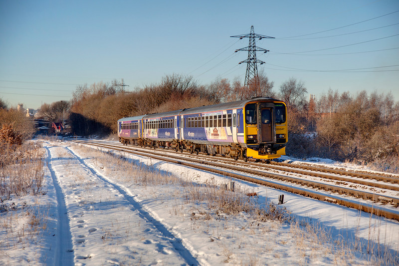 155347 is seen at Ravensthorpe leading the 10:35 Huddersfield to Wakefield Kirkgate service on a wintry December 6th 2011.