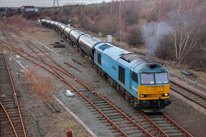 60074 departing HM yard after a crew change with a 6E32 Preston to Lindsey empty bitumen tanks on December 13th 2010..  At this point the train was running over 4 hours late due to failing on the outbound run.  I had to up the ISO to 3200 to get a 205th shutter!