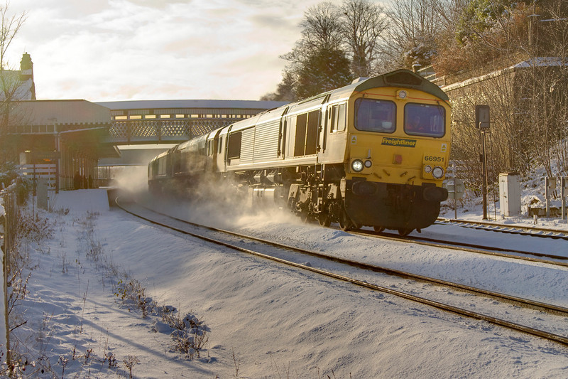 66951 lifts the snow heading through Dewsbury with an 0Z25 Crewe to Midland Road comprising of 66538 66514 & 66524 on January 6th 2010.
