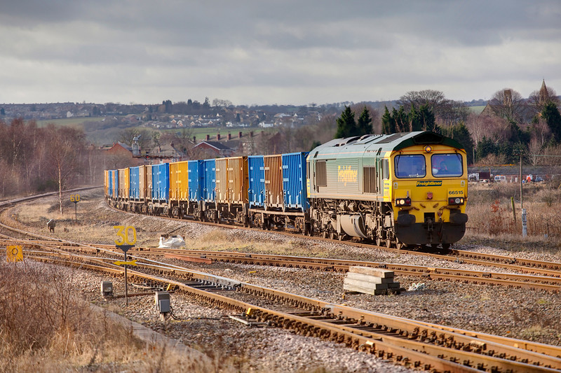 66515 is seen at Horbury Junction with a 6E06 Bredbury to Roxby bins on January 28th 2010.