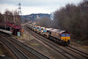 "66167 is seen at Thornhill L&NWR ""Wessy"" Junction crawling into an engineering posession with a 6T53 12:30 Doncaster Decoy to Mirfield on January 24th 2010.  The work on this occasion as to renew the track on the Manchester bound curve at Heaton Lodge Junction"