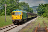 33109 heads towards Ingrow up the GN straigth with the 13:58 Keighley to Oxenhope on June 11th 2010.