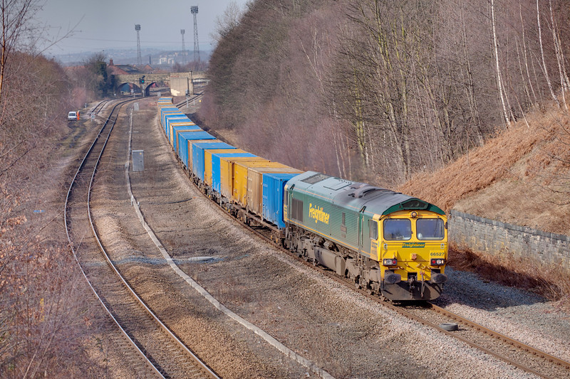 66527 is seen at speed passing Addingford Lane in Horbury Cutting while working a 6E06 Bredbury to Roxby GMC Binliner on March 5th 2010.