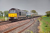 67005 is seen approaching Hagg Lane Level Crossing with a 1D34 13:10 London Kings Cross to Wakefield Westgate onMay 1st 2010.