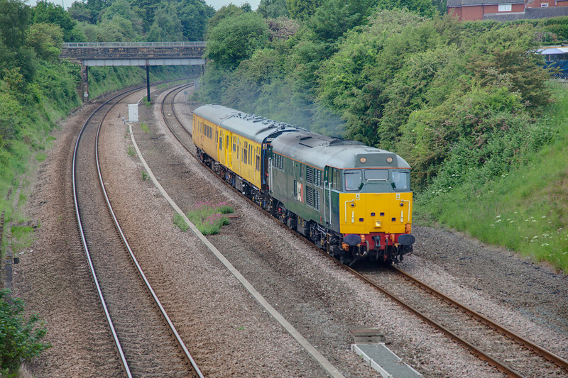 With Driver Rogers at the controls, 31601 is seen in Horbury Cutting while working a 2Q08 Derby RTC to Doncaster TRU on May 7th 2010.