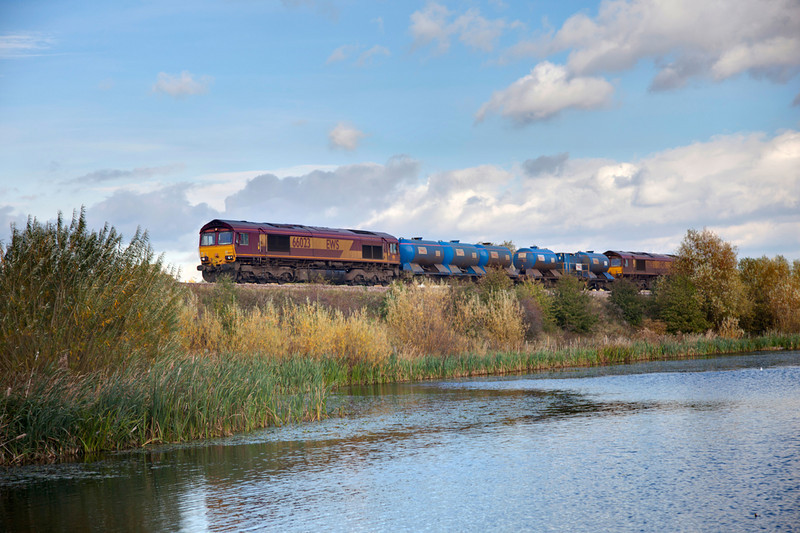 66023+66125 pass the ponds at horbury with A 3S14 11:14 Grimsby Town to Malton on October 22nd 2011.
